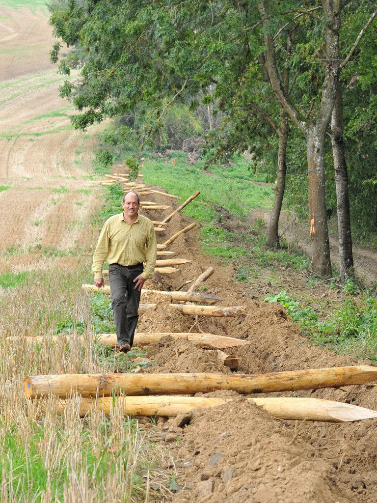 Gregoire Callies prepares to erect a 6-km-long fence along the borders of farmlands to surround a hunting field which he manages in Brignancourt, in Val d'Oise,