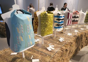 """KOMECTION 2014"" is a display of colorful rice bags."