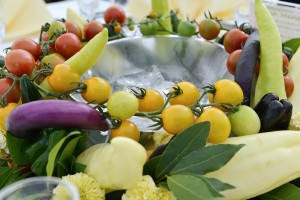 Guest tables' centerpieces are made of tomatoes, green peppers and other vegetables. Guests are invited to pick and eat them.