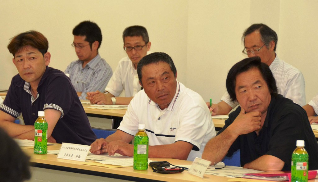 Local farmers attend a meeting to discuss causes of rice crop contamination, held Friday, July 18, in Minamisoma, Fukushima Prefecture.