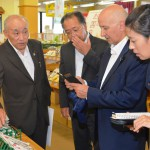 Bancel (second from right), a member of the board of International Co-operative Alliance, receives explanation from JA Sawaisesaki head Hideyuki Kojima (left) at a farmer's store in Isesaki, Gunma Prefecture, on Tuesday, Sept. 2.