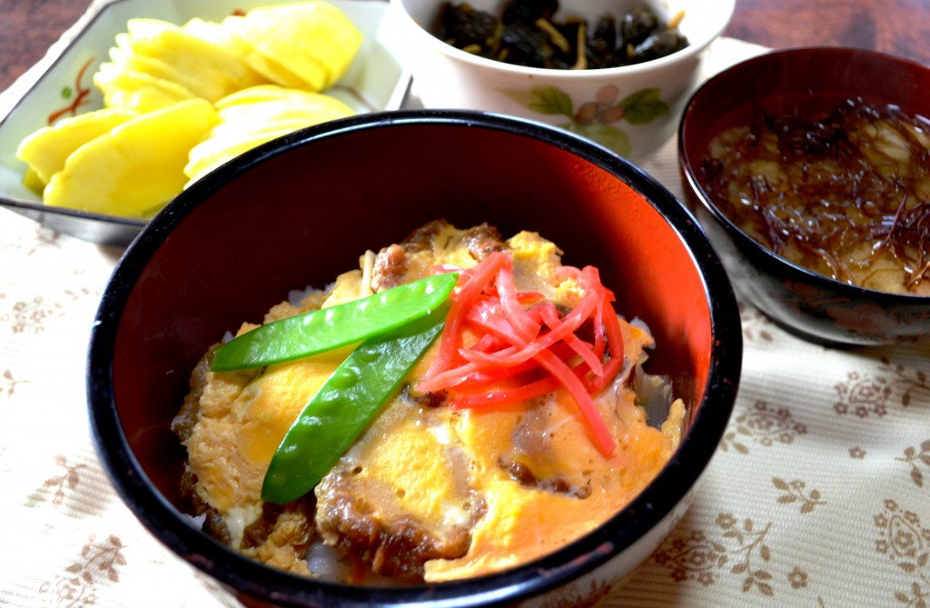 Bowl of rice topped with Abura-fu cooked in mouth-watering sweet-salty soup broth.