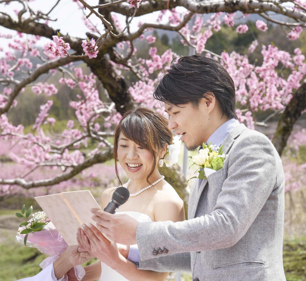 Jumpei and Akina pledging undying love in front of peach tree in full bloom