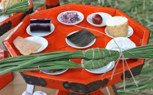 Nine offerings to gods: chimaki (sweet rice dumplings), mochi (rice cake), yamaimo (Japanese yam), kombu (Japanese edible kelp), shiira (dried dolphinefish), nori, surume (dried cuttlefish), eggplant, and ikuri (local prume)