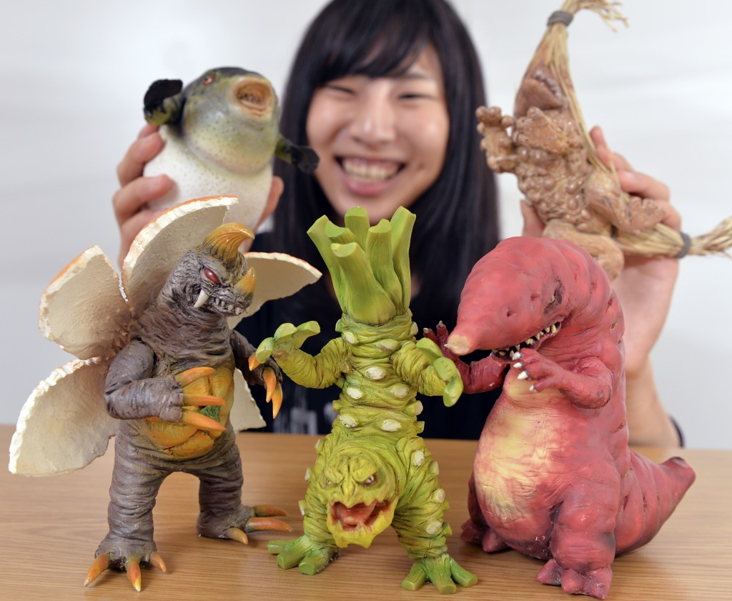 """Figures of """"local monsters"""" designed based on local agricultural specialties. Front row (from left to right): Mikagerasu based on mandarin orange (mikan), Twoon based on horse radish (wasabi with """"twoon"""" pungency), and Imorasu based on sweet potato (satsumaimo). (in Chiyoda-ku, Tokyo)"""