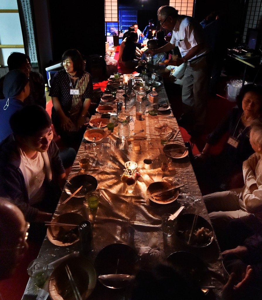 People enjoyed dinner in candlelight