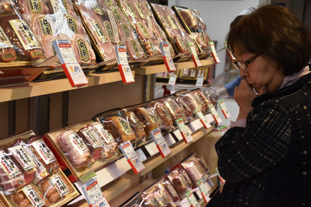 A woman looks at ham products at a yearend gift sales campaign at Tobu Department Ikebukuro store in Tokyo's Toshima Ward