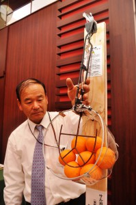 A Sugimoto Kogyo official shows a snare trap for wild monkeys fixed onto a board