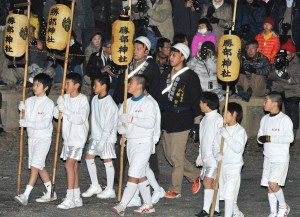 Group of local school children holding lanterns led parade of torch bearers.
